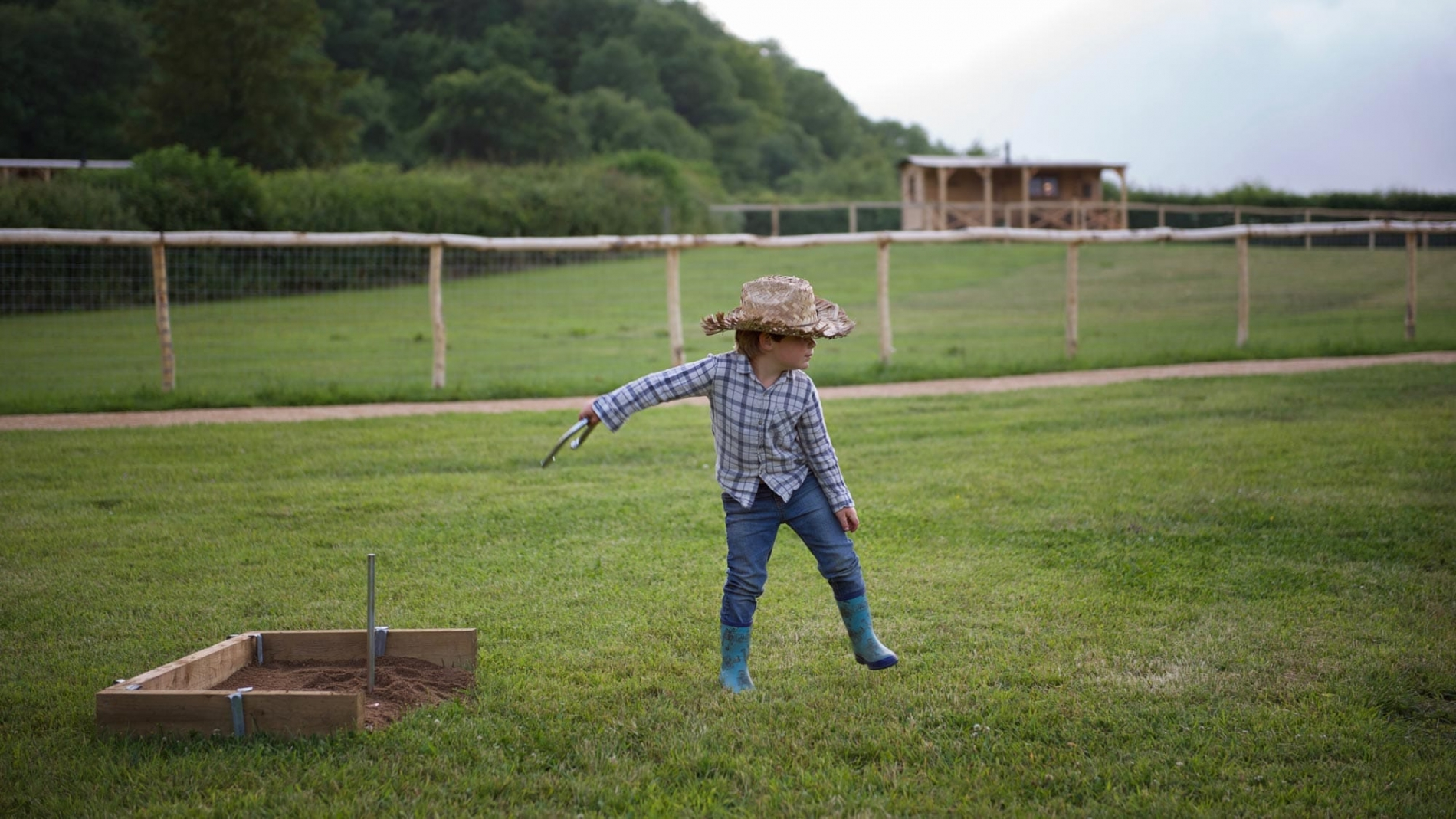 Child playing outdoors at Loose Reins Glamping Dorset
